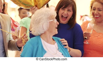 Surprise Birthday Party! - Senior woman is being surprised ...