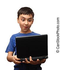 surprise boy with laptop
