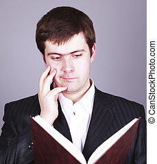 Surprise Businessman with book