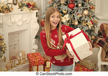 Surprise. Child enjoy the holiday. Christmas tree and presents. Happy new year. Winter. xmas online shopping. Family holiday. The morning before Xmas. Little girl