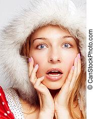 Surprise Christmas concept - one amazed woman