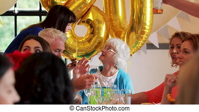 Surprise Dinner Party for Gran - People are enjoying food...