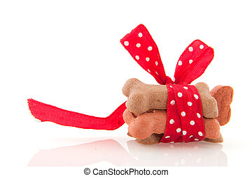 surprise bones with ribbon and bow for the dog
