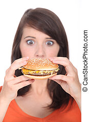 Surprise in front of a hamburger