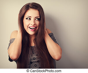 Surprise makeup beautiful woman holding head the hands and...