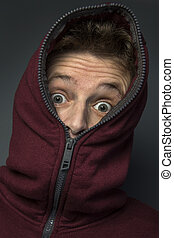 Surprise - Man in hoody with a look of surprise on his face.