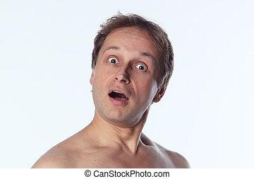 Portrait of a suprise middle age man with naked shoulder