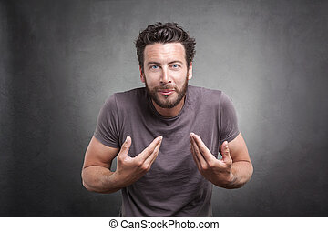Frontal portrait of surprised adult man getting unexpected attention from people, asking you talking to, mean me? pointing finger at himself isolated on grey background. Facial expression body language