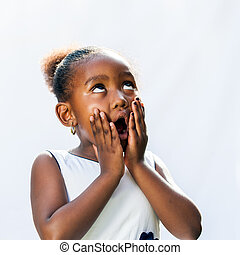 Surprised african girl with hands on face.