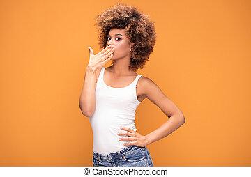 Surprised amazed beautiful afro woman .