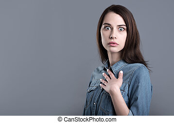 Surprised and confused young woman