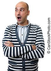 surprised bald man looking side