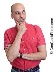 surprised bald man wearing red shirt looking side