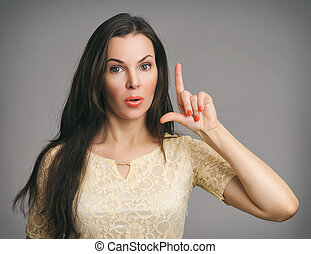 surprised Beautiful Woman pointing up her finger