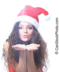 Surprised beautiful young woman in a Santa hat. Isolated on white.