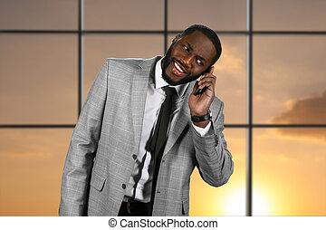 Surprised black man with phone.