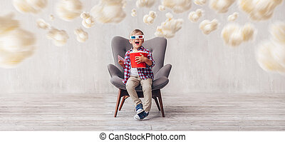 Surprised boy in 3d glasses in cinema