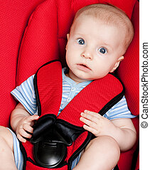 surprised boy in car seat