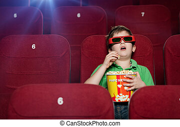 Surprised boy in the movie theater