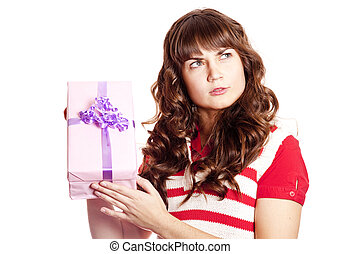 Surprised brunette girl with present box.