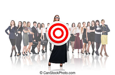 Surprised business woman holding big target