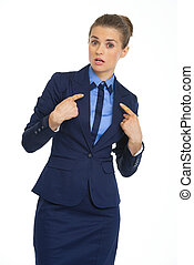 Surprised business woman pointing on herself