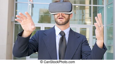 Surprised businessman celebrating success in virtual reality working experience