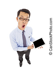 surprised businessman holding a tablet