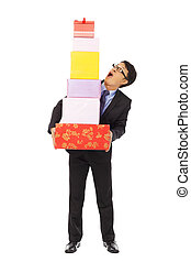 surprised businessman holding gift boxes . isolated on white bac