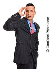Surprised businessman in suit