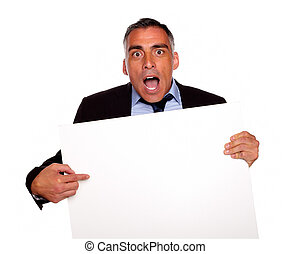 Surprised businessman pointing a card