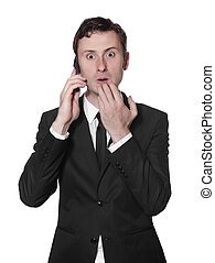 surprised businessman with a mobile