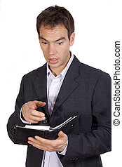 surprised businessman with diary