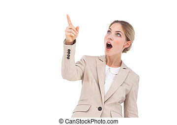 Surprised businesswoman pointing something on the sky
