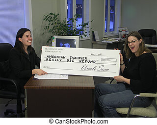 Surprised by a big refund 2 - A surprised woman receives an...