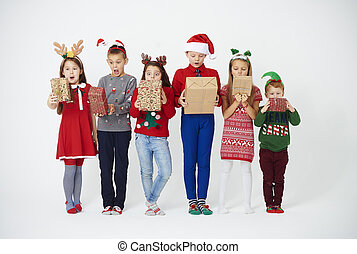 Surprised children looking at their christmas present
