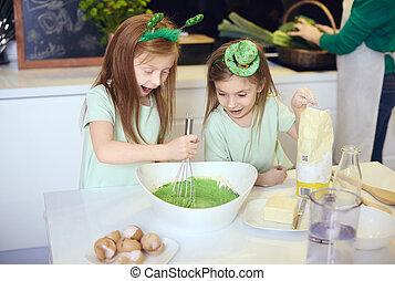 Surprised children mixing fondant icing