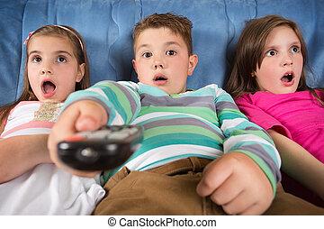 Surprised children watching TV