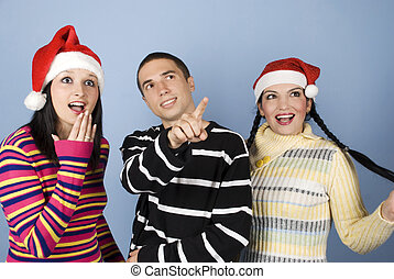 Surprised Christmas people faces looking up - Group of young...