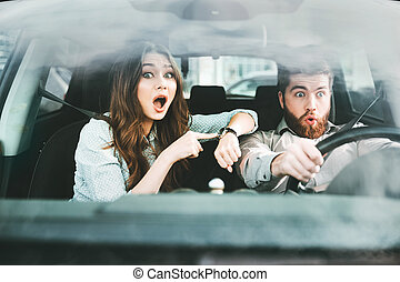 Surprised couple in car