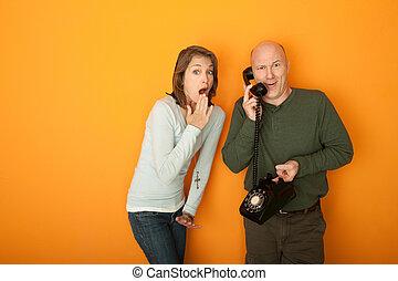 Surprised Couple on Phone