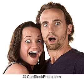 Surprised white man and woman over isolated background