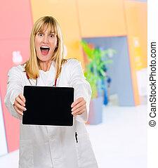surprised doctor holding a digital tablet