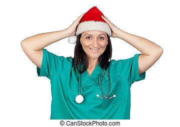 Surprised doctor woman with Christmas hat