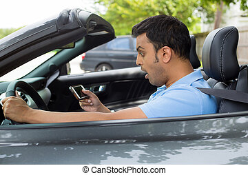 Surprised driver - Closeup portrait, funny young shocked man...
