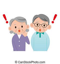 Surprised elderly couple
