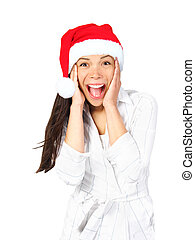 Surprised excited christmas woman