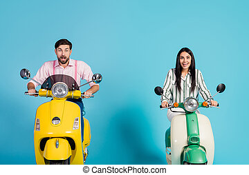 Surprised excited wife husband drive choppers see incredible sales news ads impressed scream wow omg wear striped pink shirt isolated over blue color background