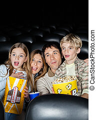 Surprised Family Watching Movie In Theater