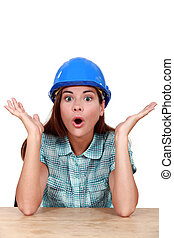 Surprised female construction worker